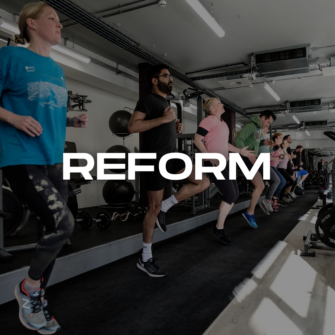 Group of clients training in a group personal training gym with bold letters reading REFORM